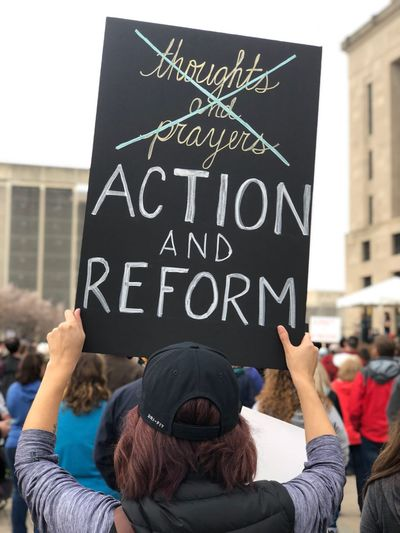 Protest sign at March For Our Lives Nashville Marchforourlives Theresistance Protest Protestor Protest Signs Gun Control Now Text Communication Day Men Placard Building Exterior One Person Human Hand Close-up Adult People The Photojournalist - 2018 EyeEm Awards