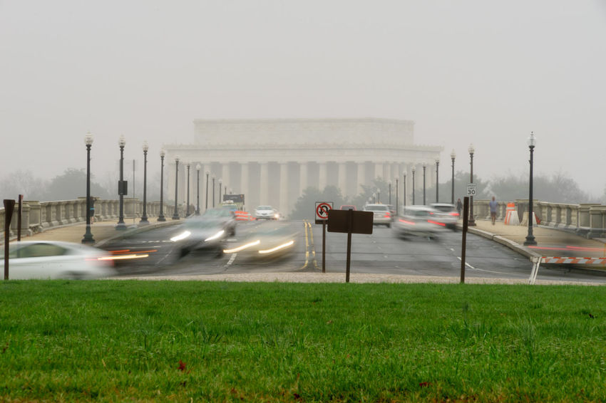 Absence Architecture Bridge Building Exterior Built Structure Car City City Life Clear Sky Connection Depth Of Field Direction Land Vehicle Leading Lincoln Memorial Memorial Mode Of Transport On The Move Outdoors Road Selective Focus Street Street Light The Way Forward Transportation