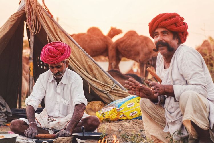 PUSHKAR FAIR '17 This is surely the best time to give a visit to the holy city Pushakar which hosts the Pushkar Mela - the world's largest cattle & livestock fair.  Traditional Clothing Only Men Outdoors Turban Sitting Young Adult Real People Market Portrait One Person Indian Culture  Indian Style Rajasthan Rajasthandiaries Rajasthani Culture Rajasthanipeople Rajasthantourism Camel Camels Pushkar Pushkarcamelfair Pushkarfair Pushkarmela Pushkardairies Pushkarrajasthan Perspectives On Nature Rethink Things Postcode Postcards EyeEmNewHere