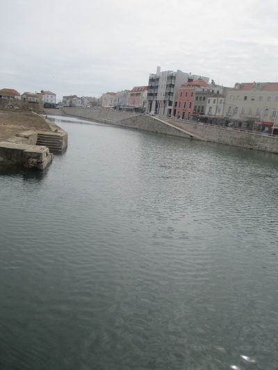 An Ordinary Day  Architecture Beauty Of Water Building Exterior Built Structure Calm Water City Cityscape Clean Water Cold Water Day Deep Water Loneliness Nature No People Outdoors Peniche Portugal Perspective Powerful Silence River Silence Sky Water Waterfront Waterscape