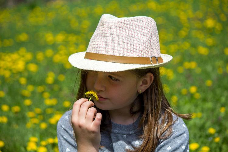 Portrait of girl wearing hat against plants
