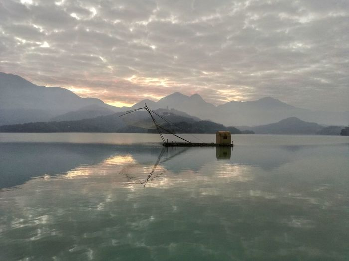 Reflection Lake No People Mountain Nature Water Outdoors Dramatic Sky Sky Scenics Cloud - Sky Beauty In Nature Day Boat Landscape Lake View Sunrise And Clouds Sunrise Sunrise Reflection Sunrise Over Water And Lake Sunrise