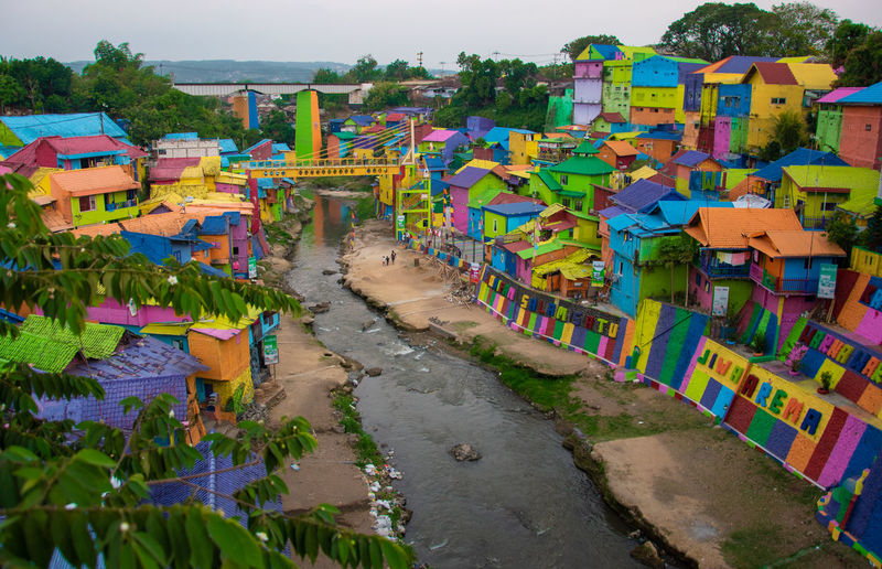 High angle view of multi colored buildings by river