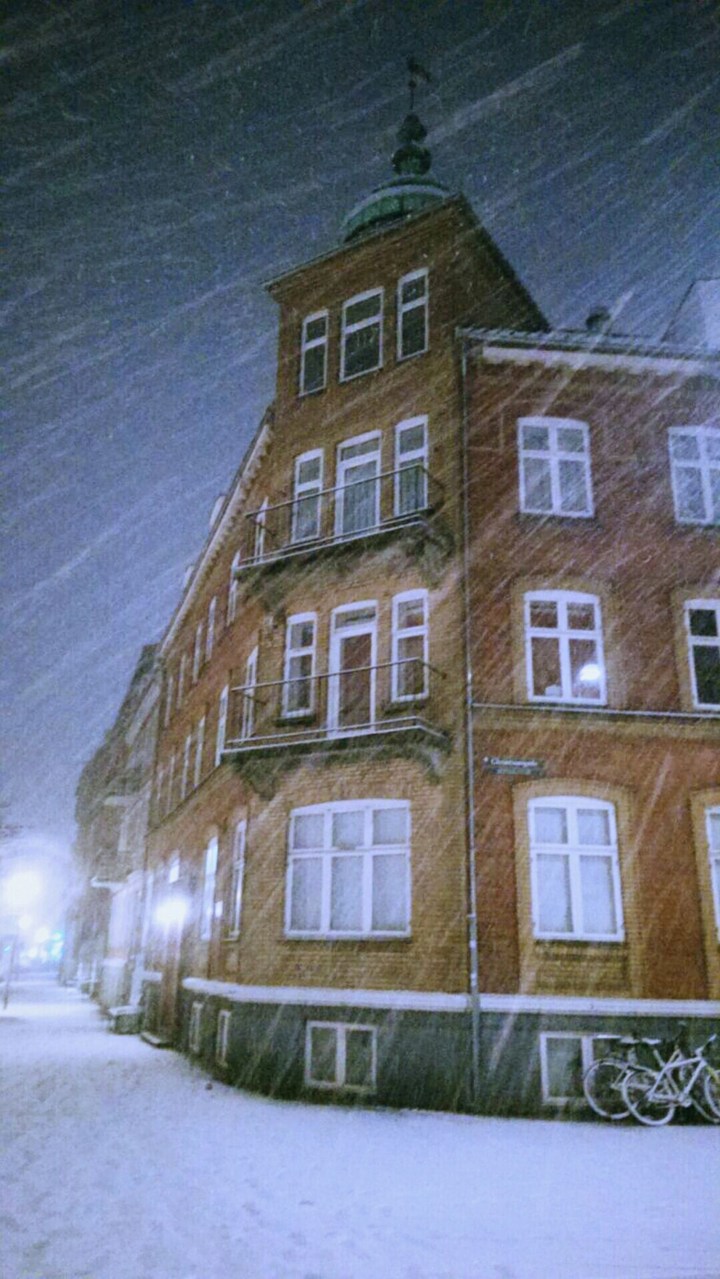 architecture, built structure, building exterior, window, sky, building, snow, cold temperature, winter, residential building, residential structure, street, day, outdoors, no people, house, facade, weather, season, road