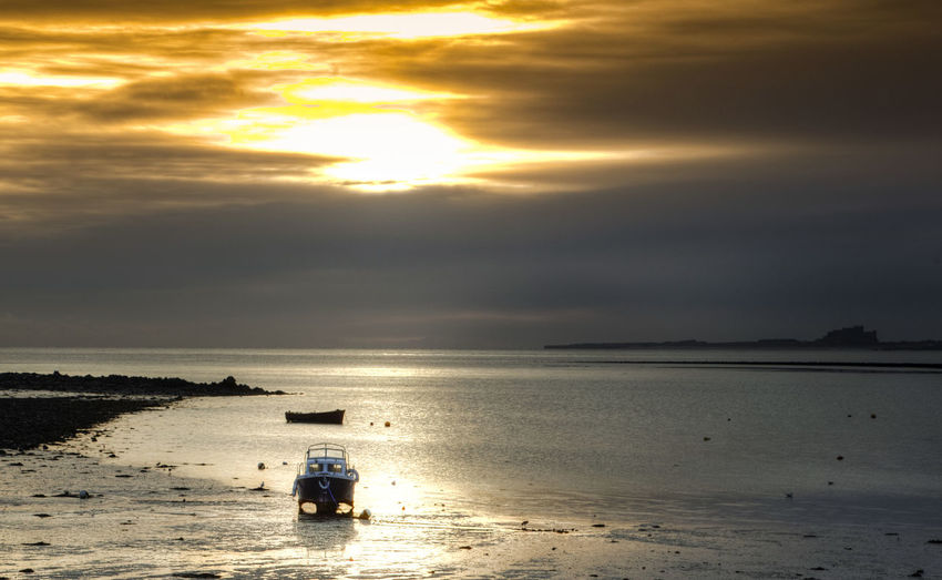 At low tide Beach Beauty In Nature Cloud - Sky Dawn Of A New Day Day Fishing Boat Horizon Over Water Low Tide, Mud Flats Nature Nautical Vessel No People Outdoors Sand Scenics Sea Sky Sun Sunlight Sunset Tranquility Water Winter Dawn