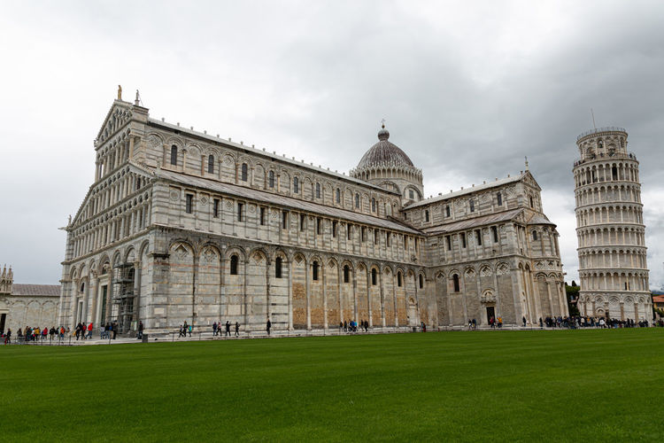 Gothic Leaning Miracles Pisa Renaissance Square Architecture Art Cathedral Church City Dome Located Marble Old Outdoors Religion Sky Tower Travel Building Exterior Built Structure Grass Tourism Travel Destinations Cloud - Sky History Nature The Past Day Plant Incidental People Building Place Of Worship