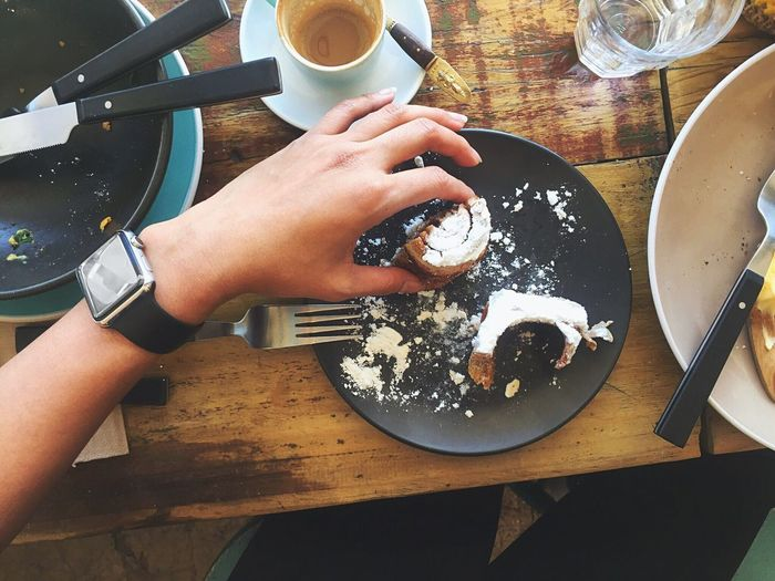 Cropped hand of woman holding dessert in plate