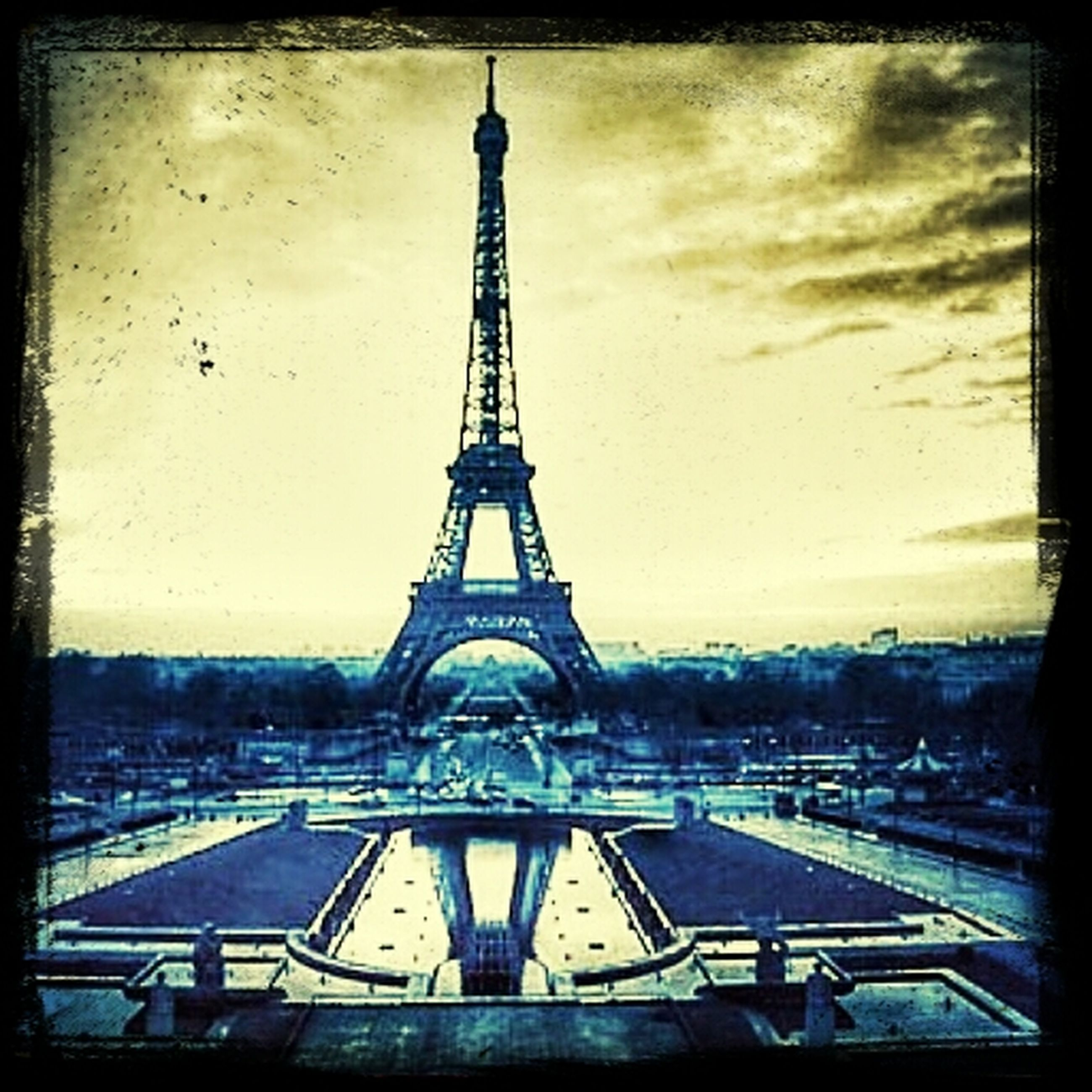 transfer print, eiffel tower, built structure, architecture, auto post production filter, sky, culture, tower, international landmark, famous place, metal, travel destinations, capital cities, tall - high, tourism, city, travel, building exterior, cloud - sky, metallic