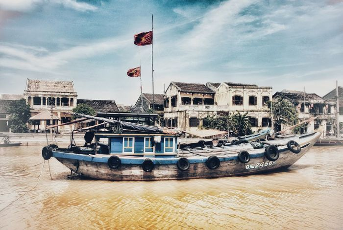 Hoi an, Vietnam Water Nautical Vessel Architecture Flag Waterfront Boat Mode Of Transport Transportation Sky Building Exterior Built Structure Day History Moored Travel Destinations Cloud - Sky Outdoors No People The Week On EyeEm Travel Photography Hoian  Hoi An, Vietnam Hoian, Vietnam Hoi An UNESCO World Heritage Site