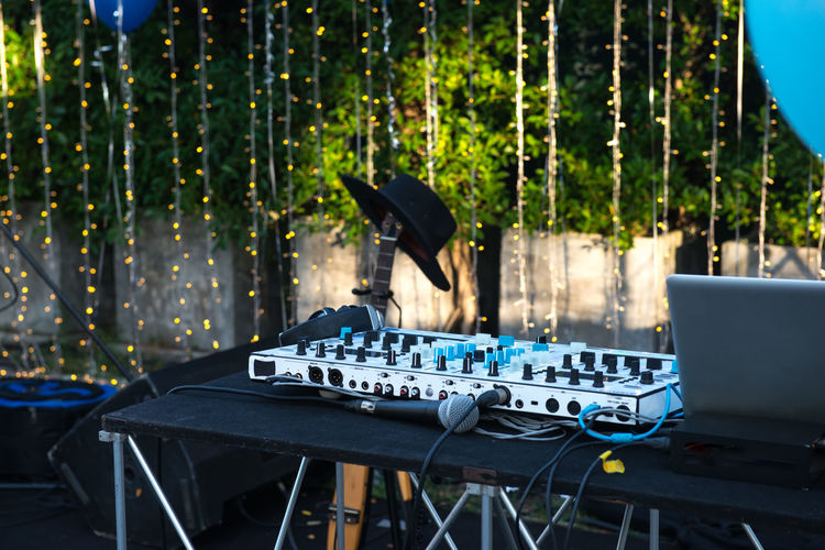Close-up of sound mixer at party outdoors