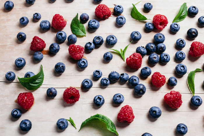 blueberry and raspberry vitamin table. top view. EyeEm Best Shots EyeEm Nature Lover Food And Drink Blueberry Eyeem Food  Healthy Eating Healthy Food Healthy Lifestyle Healthyfood Mint Raspberry Top View Wood - Material