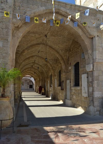 Stone archway / passage with vaulted ceiling at St. Lazarus Church, Larnaca city centre, Cyprus Larnaca Larnaka Palm Tree Plant St. Lazarus Church Tree Arch Architecture Built Structure Bunting Day Flag Greek Flag Indoors  Larnaca, Cyprus No People Religion Stone Architecture Vaulted Ceilings