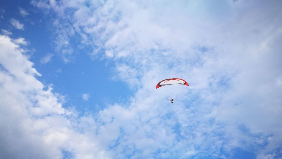 Low angle view of paraglider against sky