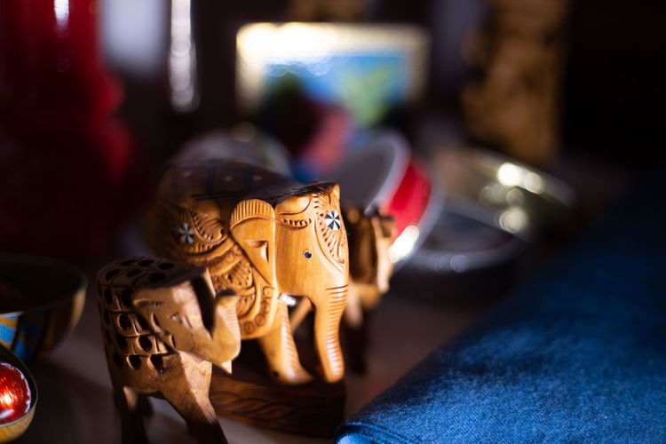 Close-up of elephant figurines on table at home