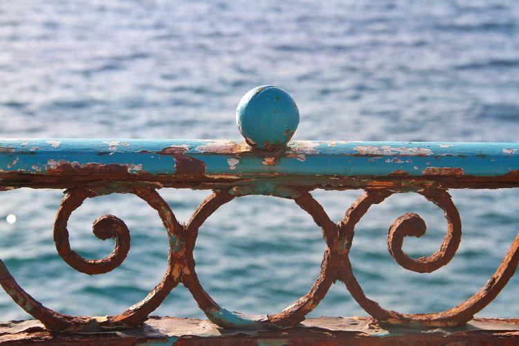Weathered railing and sea