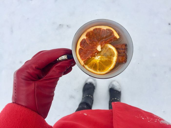 High Angle View Of Woman Holding Drink During Winter