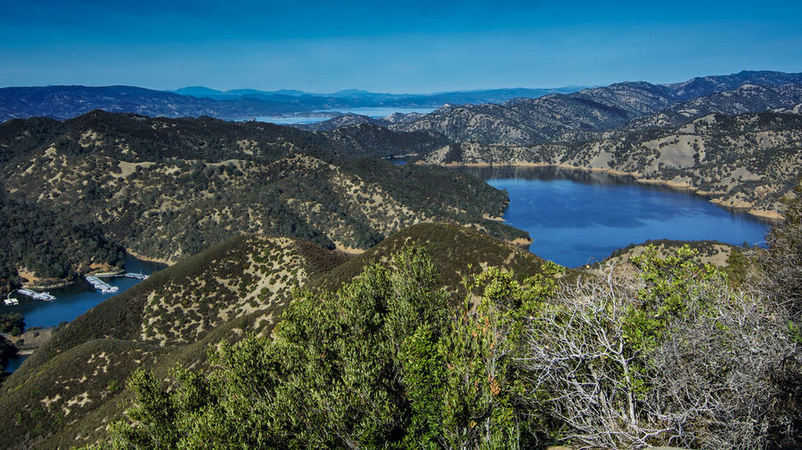 Aerial view of Lake Berryessa from the Blue Ridge Trail, Stebbins Cold Canyon, on a sunny day, featuring the surrounding blue oak woodland and the cove marina in the fall of 2017 Water Scenics - Nature Mountain Beauty In Nature Tranquil Scene Tranquility Sky Nature No People Lake Blue High Angle View Non-urban Scene Environment Mountain Range Outdoors Day Lake Berryessa Blue Ridge Trail Stebbins Cold Canyon Cold Canyon Napa County Ca Yolo County UC Davis USA