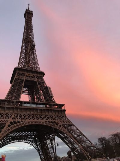 Low angle view of eiffel tower against sky during sunset