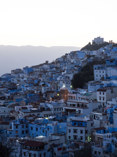 Blue Neighbourhood. View of Chefchaouen, Morocco from the Spanish Mosque EyeEmNewHere Morocco Olympus Travel Travel Photography Architecture Blue Building Exterior Built Structure Chefchaouen Cityscape Clear Sky High Angle View House Mountain Outdoors Residential District Town TOWNSCAPE Travel Destinations The Traveler - 2018 EyeEm Awards The Architect - 2018 EyeEm Awards