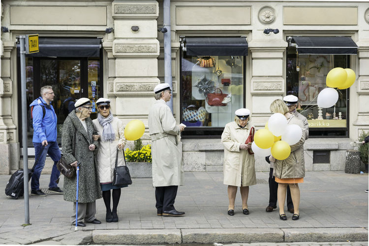 Some old people waiting for a taxi after celebrating the Vappu day in Helsinki, Finland Balloon City People Grand Parents Lifestyle Old People People Sailor Cap Street People Vappu Vappu Day Waiting For Taxi