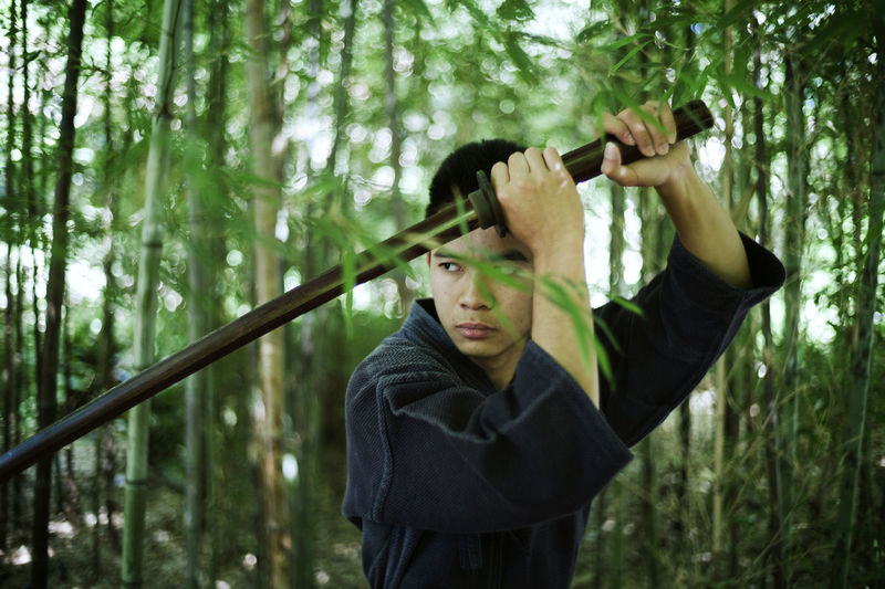 The modern samurai. Adult Bamboo - Plant Day Forest Holding Nature One Person Outdoors People Real People Tree Young Adult