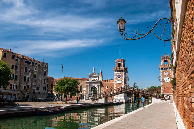 View of the venetian arsenale against sky in city