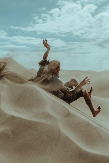 Man enjoying on sand dune
