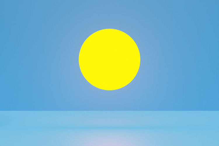 Close-up of yellow ball against blue background