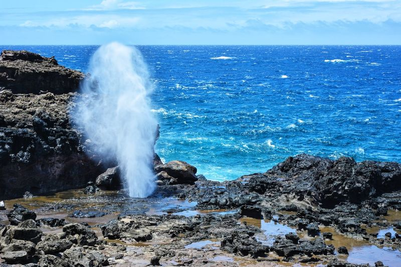 HAWAII Beauty In Nature Blue Cloud - Sky Day Horizon Over Water Idyllic Motion Nature Outdoors Power In Nature Remote Rock Rock - Object Rock Formation Scenics Sea Seascape Shore Sky Splashing Tranquil Scene Tranquility Vacations Water Wave
