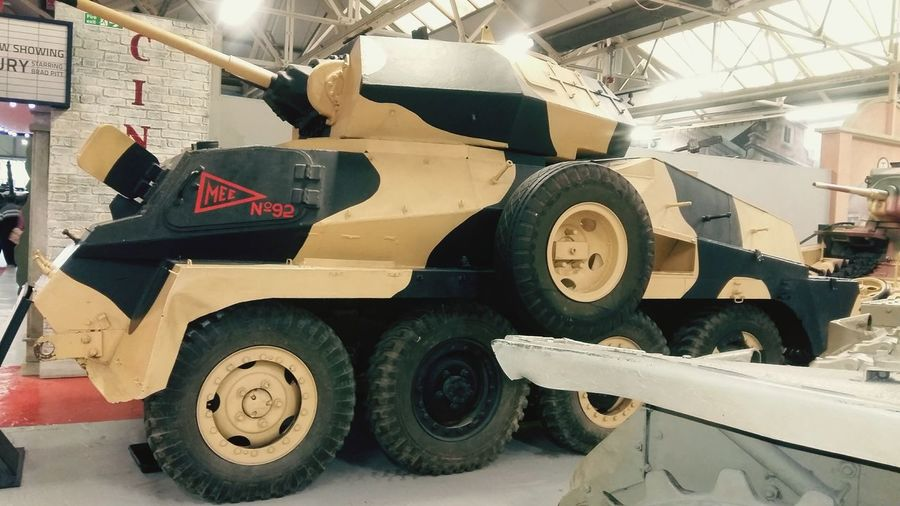 A Armored Vehicle in Desert Camo at the Tank Museum United Kingdom . Featuring Tire Wheel Dirty No People Day Indoors  Close-up War War Vehicle War Machine History Military Museum History Coming To Life Weapon Wheel Transportation Daytime Mode Of Transport