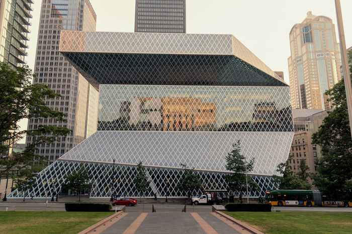 Seattle public library flagship downtown location. Construction Environmental Green Seattle Site Seeing Architecture Building Exterior Built Structure City Day Design Downtown District Glass Landmark Modern No People Outdoors Travel Destinations Tree