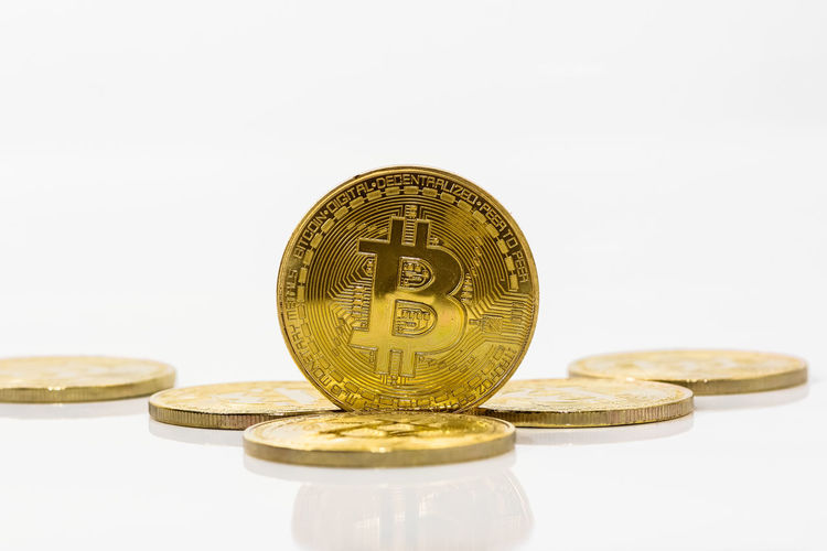 Close-up of bitcoins on white background