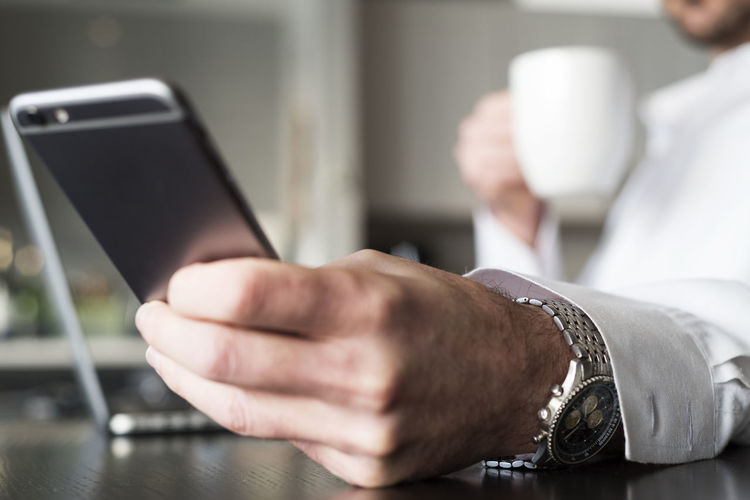 Close-up of man using mobile phone