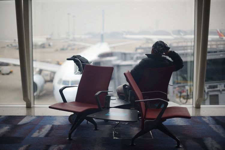 Terminal Airport Airport Departure Area Airport Terminal Passenger Airplane Voyager HongKong Looking Through Window Looking Into The Future Chair Window Arrival Departure Board Airport Runway