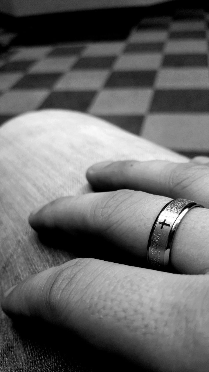 Extreme Close Up Of Hand With Finger Ring