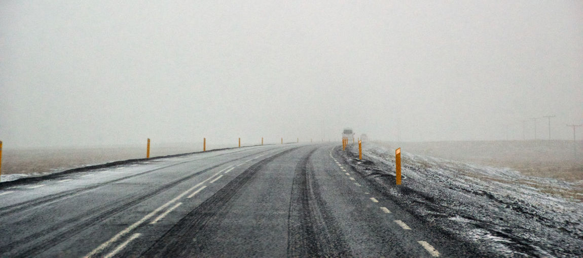 Black And White In Colour Changing Weather Cold Cold Temperature Fog Foggy Weather Ice Iceland Journey Remote Road To Nowhere Road Trip Roadtrip With The Cousins Snow The Way Forward Travelling Weather Yellow Sticks Zero Visibility