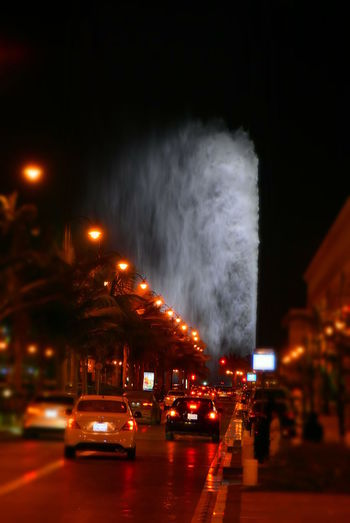 Fountain Jeddah Fountain Architecture Building Exterior Built Structure Car City Illuminated Land Vehicle Mode Of Transport Motion Night No People Outdoors Road Sky Street Transportation The Creative - 2018 EyeEm Awards