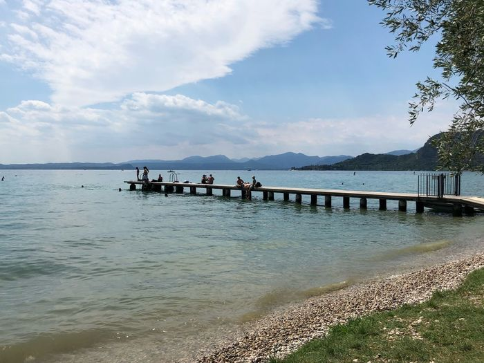 Steg Gardasee Water Sky Sea Beach Cloud - Sky Group Of People Beauty In Nature Nature Land Day Nautical Vessel Outdoors Sunlight