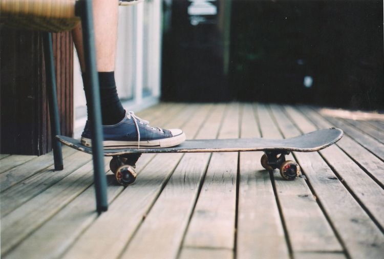Low Section Of Man On Skateboard