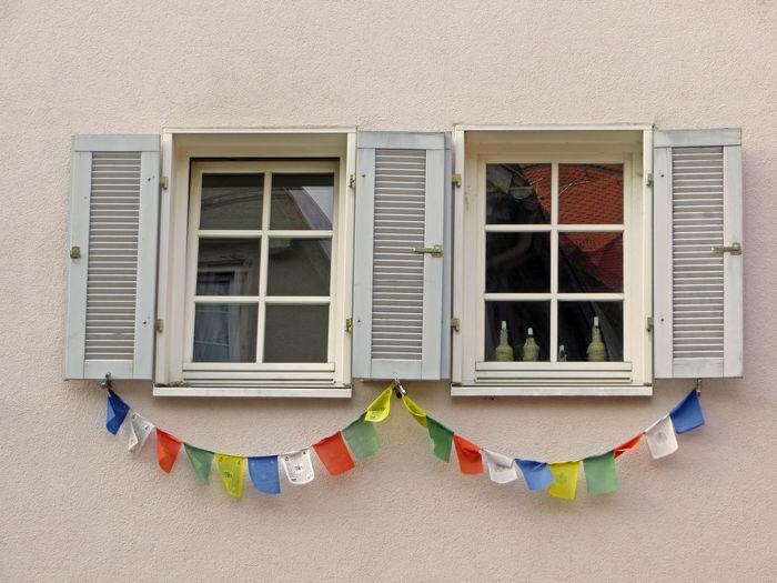 Praying flags on building windows