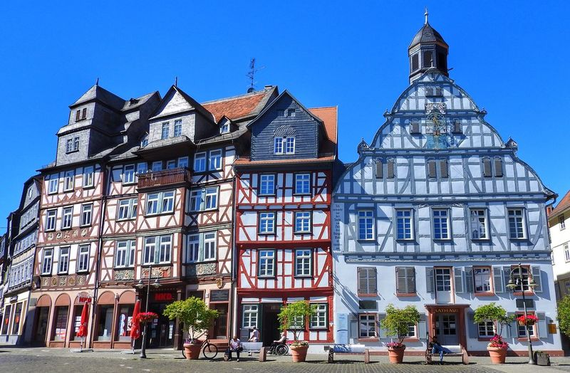 Facades of halftimbered houses Halftimbered Houses Built Structure Building Exterior Architecture Building City Sky Clear Sky Day Window Street Blue Incidental People Transportation Façade