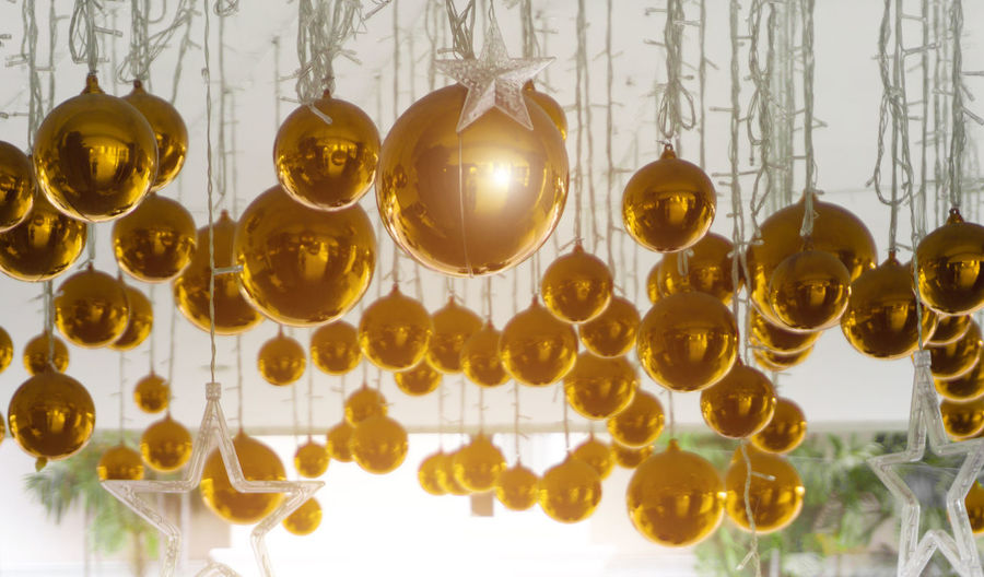 Bright Christmas balls, yellow and gold background for the Christmas design ideas. Holiday Christmas Merry Background Xmas Decoration Ball Celebration Celebrate New Ornament Year Decor Winter Yellow Concept December Hanging Season  Festive Light Happy Decorative Card Sphere Design Round Seasonal Greeting Bauble Glass Bow Banner Symbol Art Shiny Ribbon Golden Snowflake Traditional Shine Gold Abstract Bright Gift Template Element Set Circle Christmas Decoration