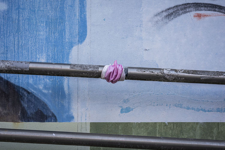 Close-up of textile on pipe against wall