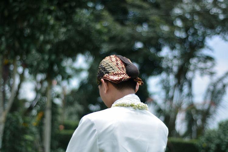 Javanese traditional wedding dress with blangkon headgear