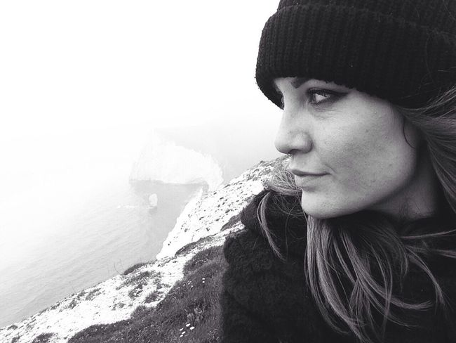 B&W Portrait Dorset Lookingout Thinking Atmospheric Durdle Door On The Cliffs