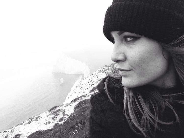 B&W Portrait Dorset Lookingout Thinking Atmospheric Durdle Door On The Cliffs