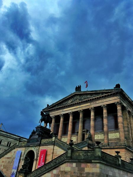 Berlin Photography Museum Island Berlin Museum Island Architecture Building Exterior Built Structure Low Angle View History Cloud - Sky Architectural Column Sky City Flag Façade Famous Place Cloud Monument Blue Outdoors Germany Photos Dramatic Angles Capture Berlin