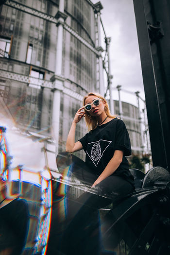 Architecture Building Exterior Built Structure Camera - Photographic Equipment Casual Clothing City Day Fashion Glasses Leisure Activity Lifestyles One Person Outdoors Photographer Photographing Photography Themes Real People Standing Sunglasses Technology Wireless Technology Young Adult