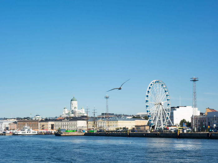 Architecture Blue Building Exterior Built Structure Capital Cities  City Clear Sky Development Engineering Famous Place International Landmark Outdoors Tourism Tower Travel Travel Destinations Helsinki Finland View From Ship Sightseeing Sea And Sky Sunny Day Day Trip Seeing The Sights