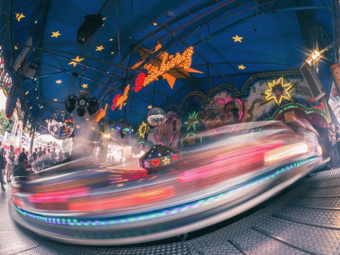 Light trails in amusement park at night